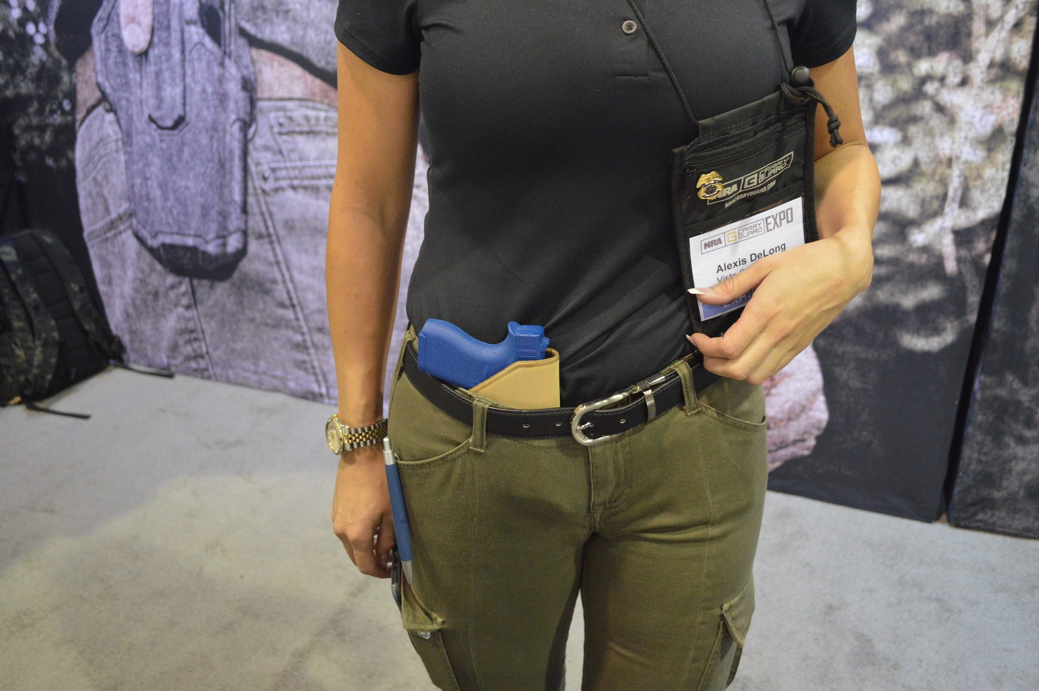 Alexis with Vista Outdoors models a Blackhawk! in-the-pocket holster with such grippy material that it stays put inside-the-waistband as well. (Photo: Kristin Alberts/Guns.com)