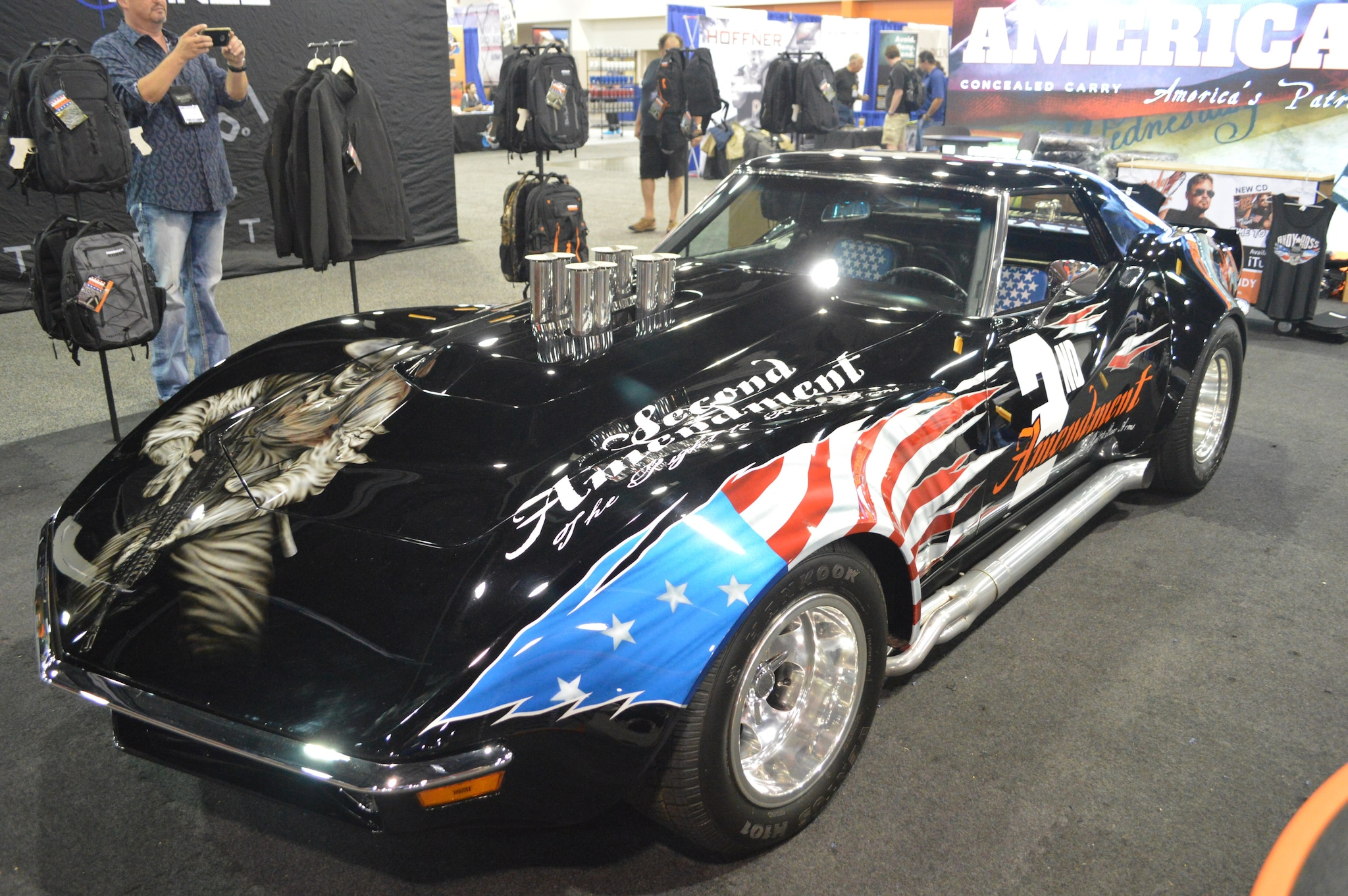 Musician Andy Ross' American Rebel brand booth set the tone for the Expo with this 2A-painted Corvette. (Photo: Kristin Alberts/Guns.com)