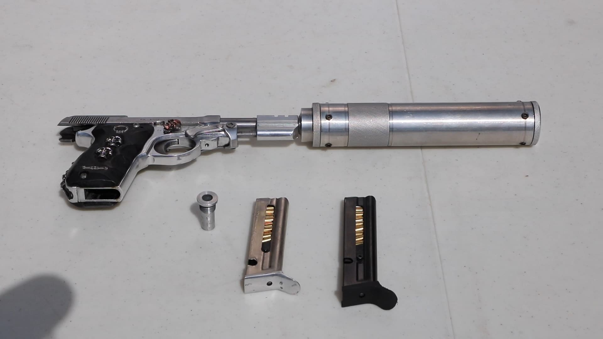 The Beretta with a seriously over-engineered suppressor