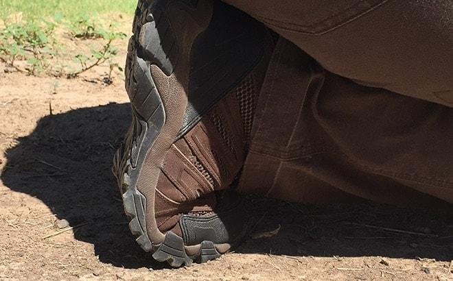 Closeup_of_firing_from_kneeling_position_in_the_Blackhawk_terrain_mid_training_shoe.