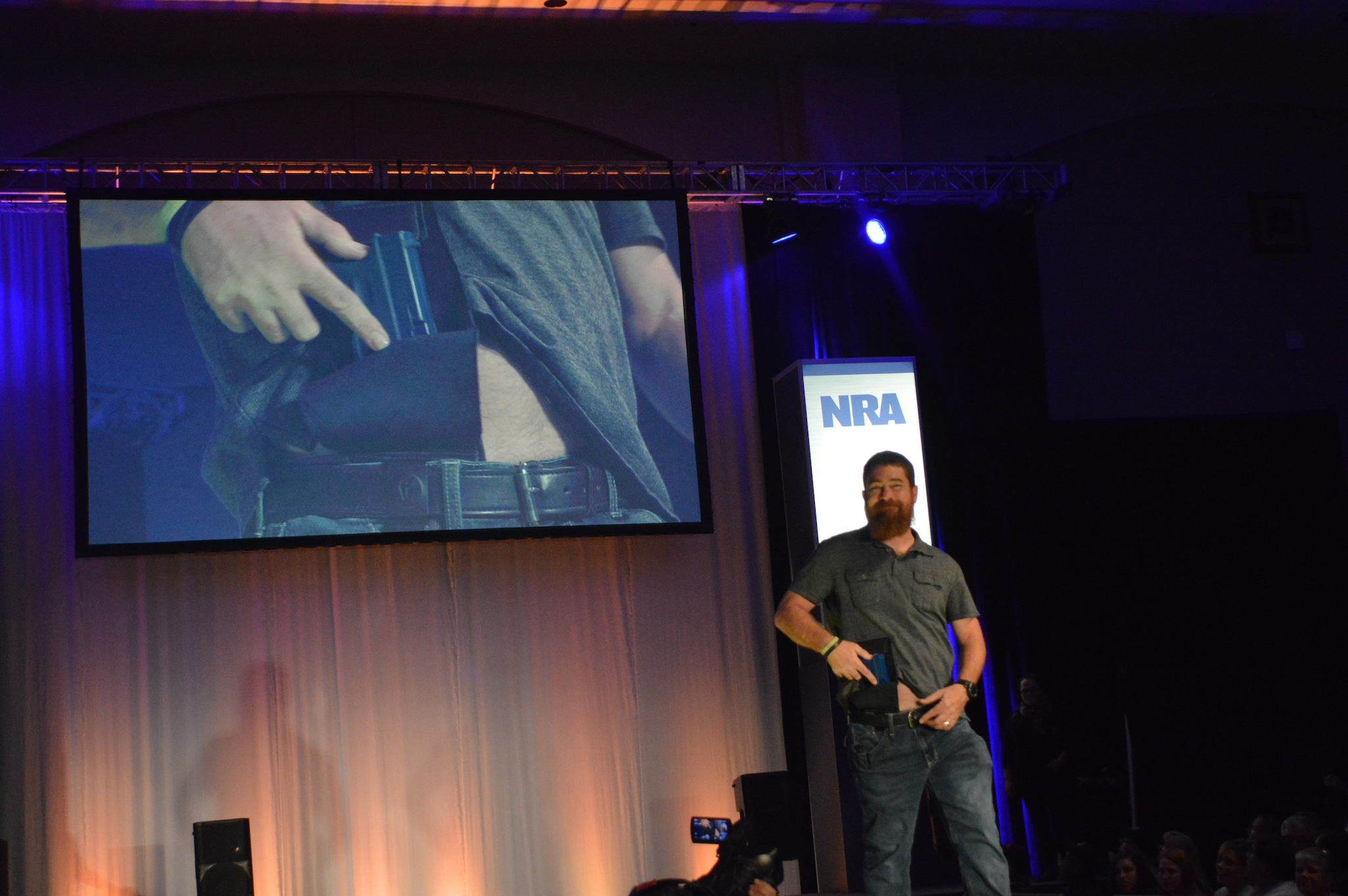 The men were not to be outshadowed by women in this fashion show. This guy is quick to access his CCW. (Photo: Kristin Alberts/Guns.com)