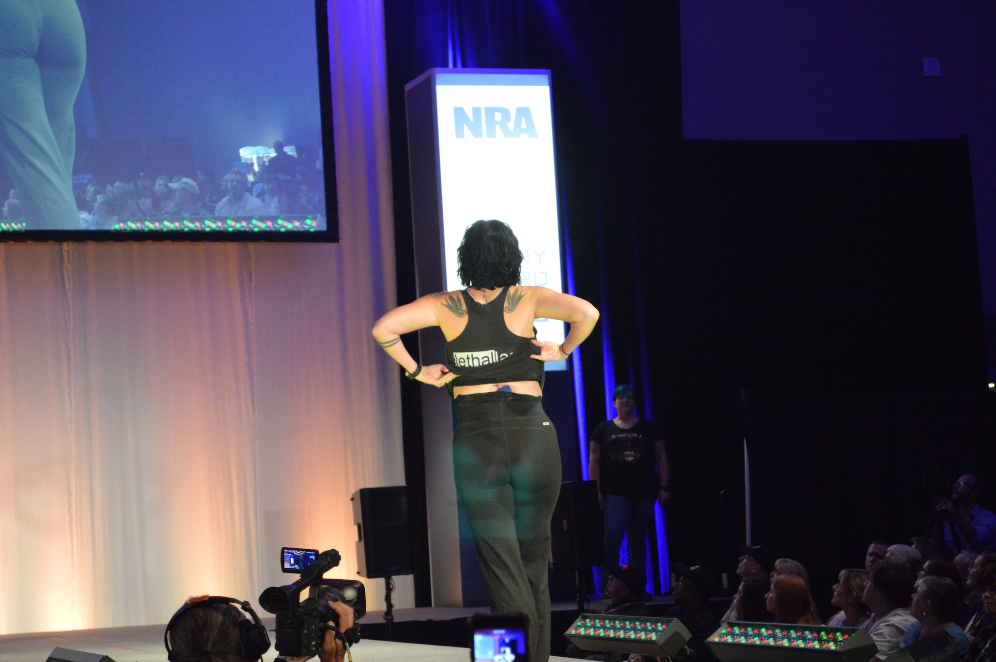 As Miss Lethal Lace leaves the runway, she flashes another gun carried at the small of her back with the Lethal Lace products. (Photo: Kristin Alberts/Guns.com)