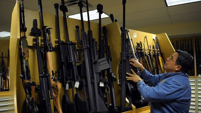 ATF Firearms Specialist Richard Vasquez is surrounded by a cache of firearms in the gun vault on March 5, 2010, at the ATF National Tracing Center in Martinsburg, West Virginia. (Ricky Carioti/The Washington Post via Getty Images)