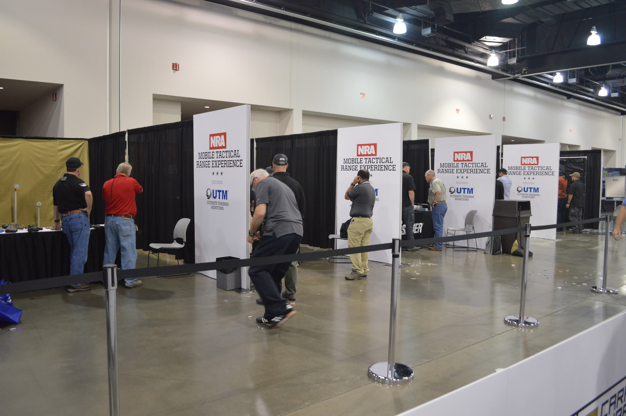 A long line of indoor range simulators was a popular spot during the Expo as attendees could test out some of the most popular guns on the show floor. (Photo: Kristin Alberts/Guns.com)