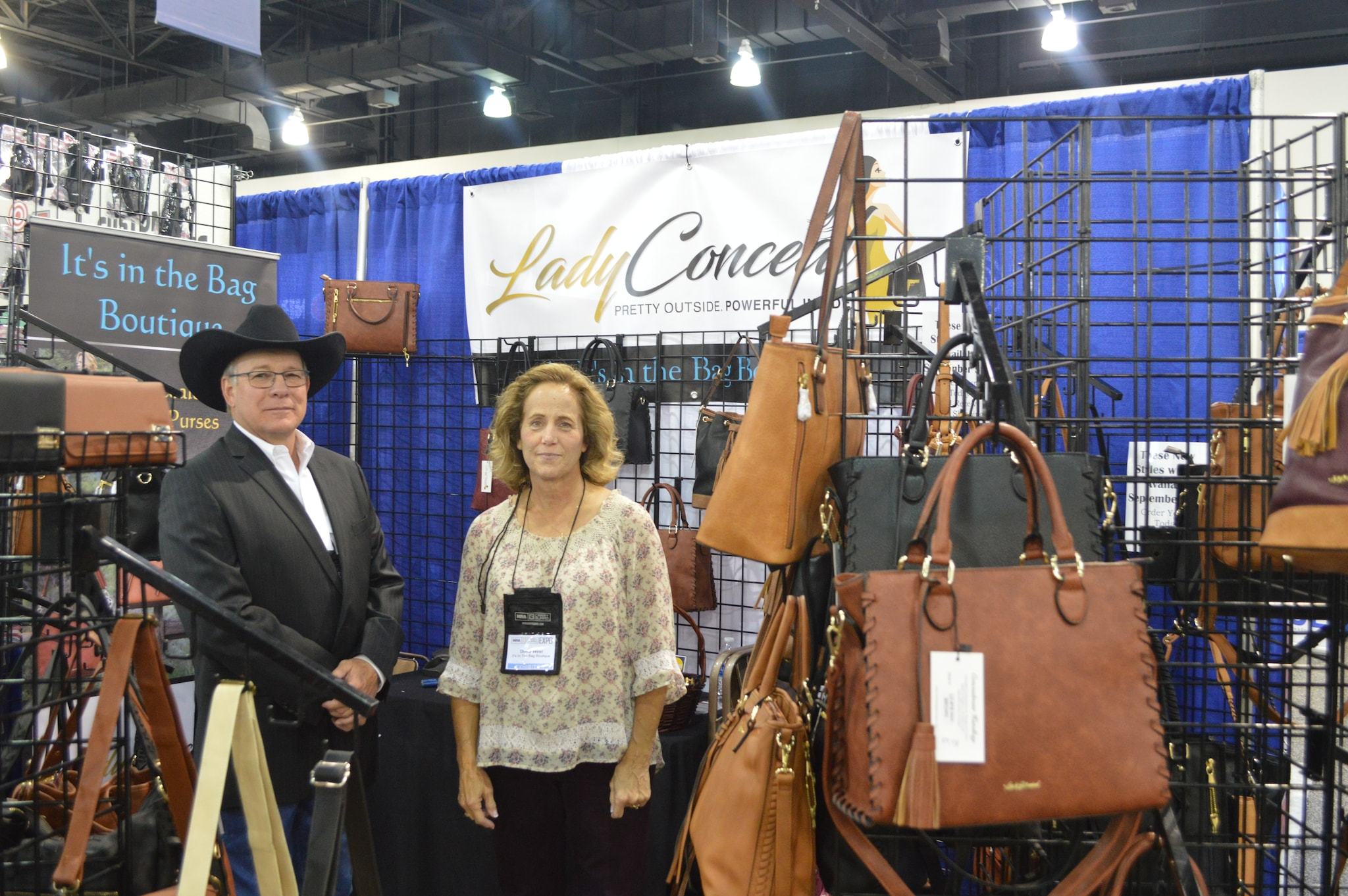 Sometimes you just meet a nice American family who makes quality gear, and that's what we found at the Lady Conceal booth. The West family shows off a full line of leather purses, handbags, and gear for men as well. (Photo: Kristin Alberts/Guns.com)