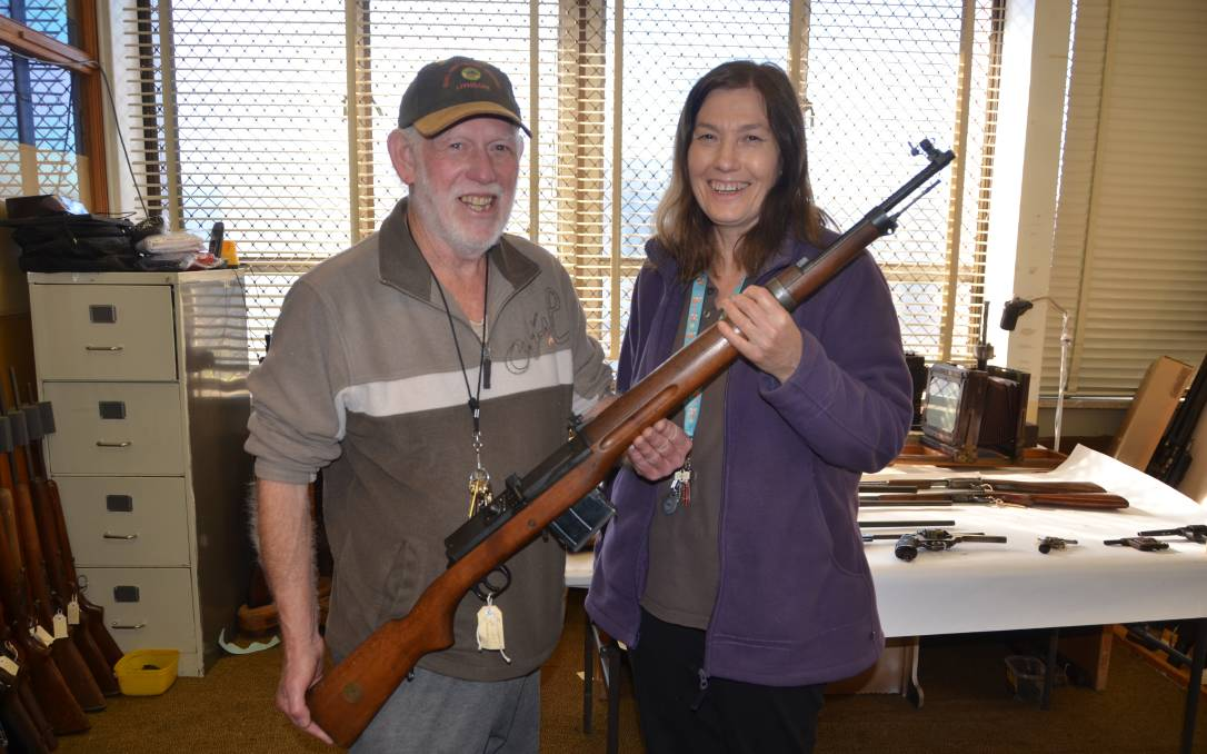 Lithgow Small Arms Factory Museum volunteers with Swedish Ljungman rifle brought in as part of the national firearms amnesty. (Photo: Phoebe Moloney/Lithgow Mercury)