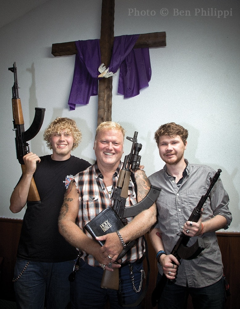 Bishop Dan Johnson and his sons Judah and Boaz photographed at The Heart of Fire Church in Louisville, Kentucky sporting their Romanian-made WASR-10 AK-47s with 50-round magazines. (Photo: Ben Philippi)