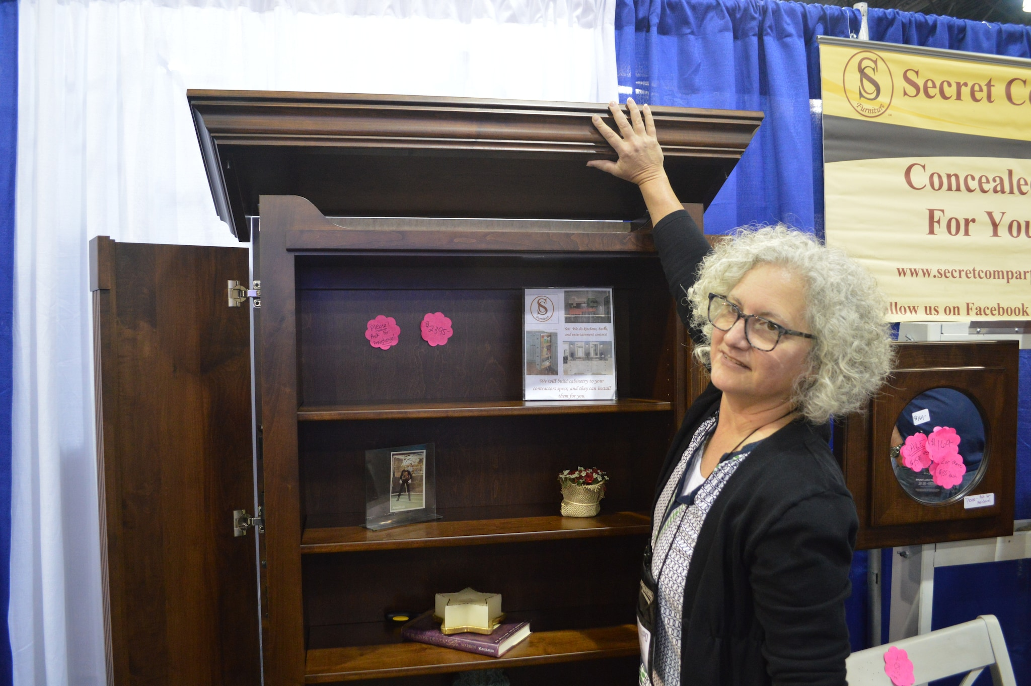 One of our favorite takeaways from the Expo--this bookcase from Secret Comparment Furniture. The top opens first, releasing the sides, which in turn allow access to a final hidden compartment. Owner, designer, and builder Jill Herro creates some high-quality, safe, hide-in-plain-sight pieces. (Photo: Kristin Alberts/Guns.com)