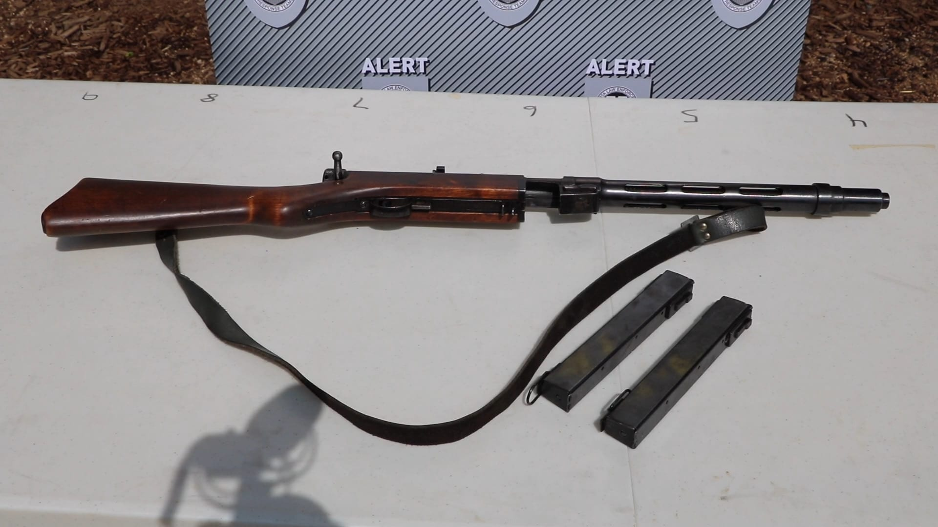 Police advise the Suomi, a Finnish subgun in 9mm, was modified but did not elaborate as to what was done to it.