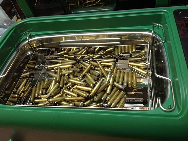 The_included_stainless_basket_can_hold_plenty_of_brass,_shown_here_with_range-scrounged_5.56_ready_for_the_hot_liquid_bath