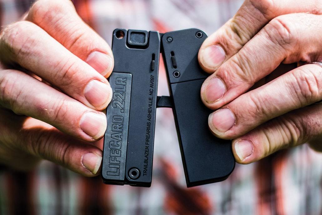 Unfolding the single shot pistol exposes the open Paterson-esque trigger