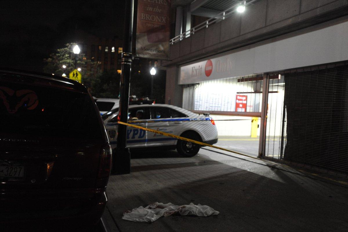 Police at the scene where a doctor jumped to his death Friday. (Photo: New York Daily News)