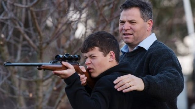 Philip Donato, member of the Australian Shooters, Fishers and Farmers Party, with his 13-year-old son. (Photo: James Brickwood/Sydney Morning Herald)