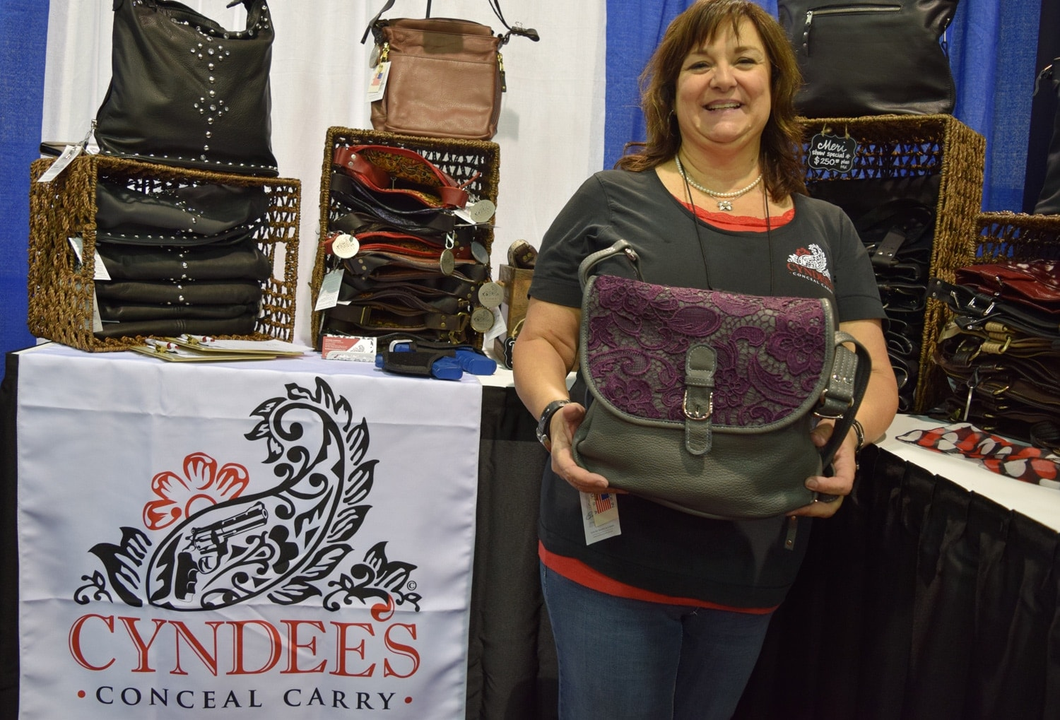 Cyndee Harding, owner and designer of Cyndee's Conceal Carry, highlights her bags and lacy motif. (Photo: Daniel Terrill/Guns.com)