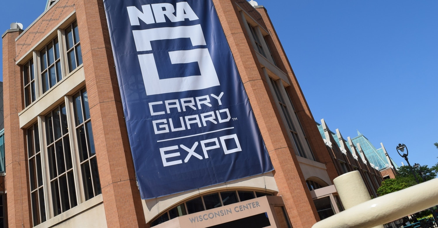"""The ginormous """"NRA Carry Guard"""" sign draped down the front entrance of the Wisconsin Center in Milwaukee on Friday, Aug. 25, 2017. (Photo: Daniel Terrill/Guns.com)"""