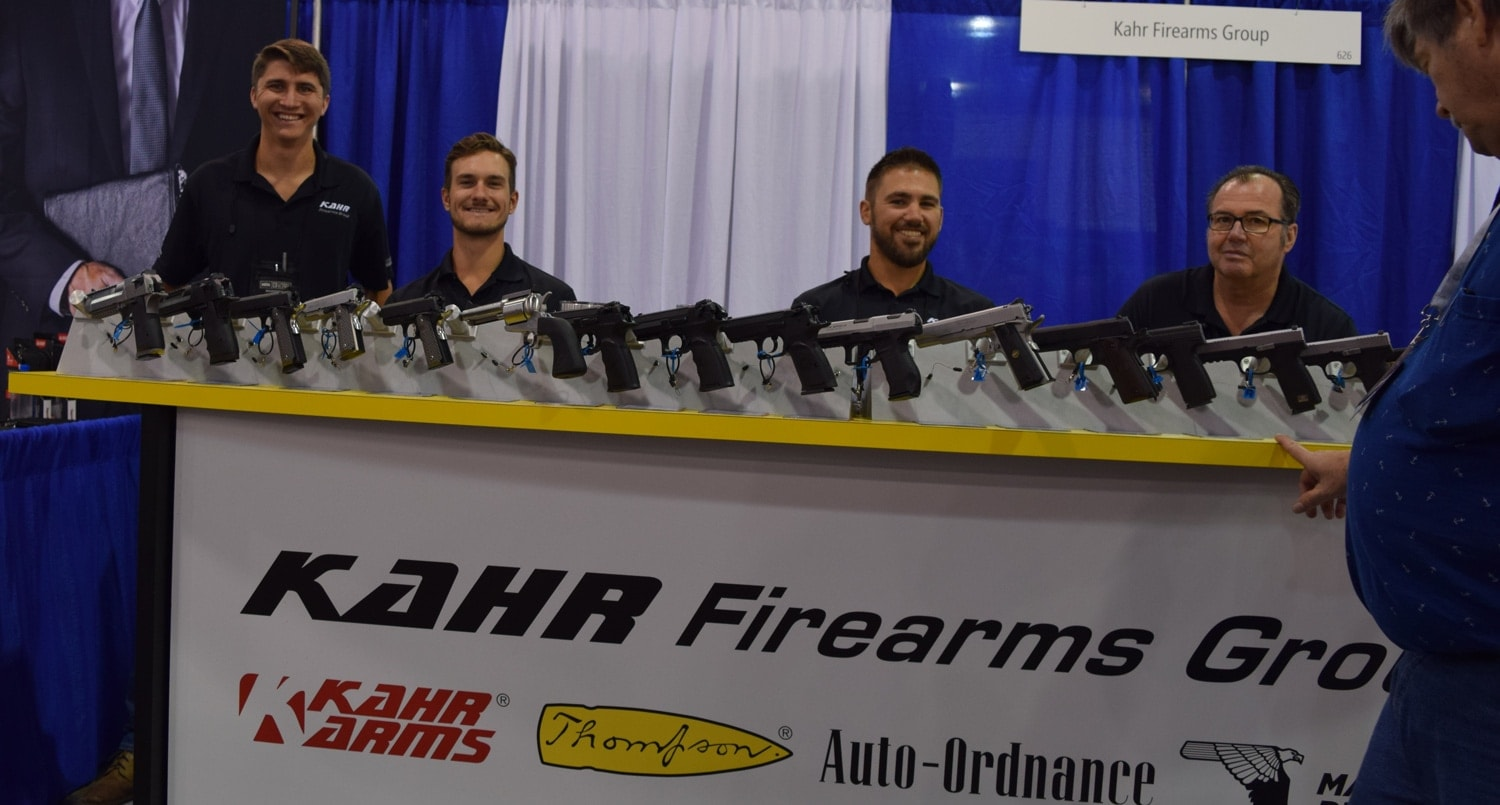 The bros at Kahr Arm sat behind their tall booth at the NRA Carry Guard Expo. (Photo: Daniel Terrill/Guns.com)