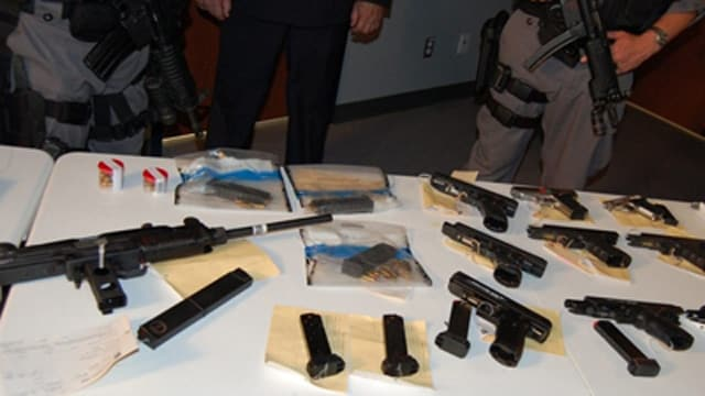 Seized guns taken during Project Rebel, a joint operation involving Ontario, ATF and U.S. Immigration and Customs Enforcement. (Photo: The Canadian Press)