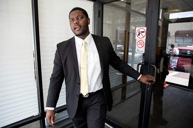 DaQuan Mosley enters Leak & Son's Funeral Homes. (Photo: Andrew Gill/WBEZ)