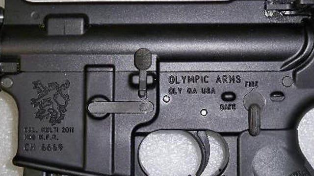 Side view of an Olympic Arms AR-15 rifle. (Photo: ArmsList)