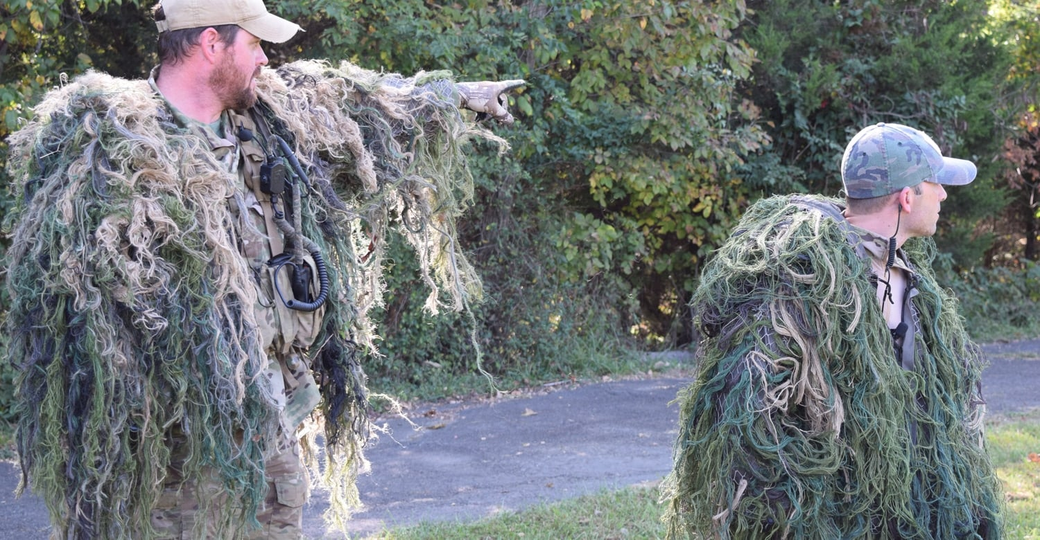 The ATF SRT sniper team wearing guillie suits pointing to where they were hiding in the woods when they shot a pumpkin from 125 yards away. (Photo: Daniel Terrill/Guns.com)