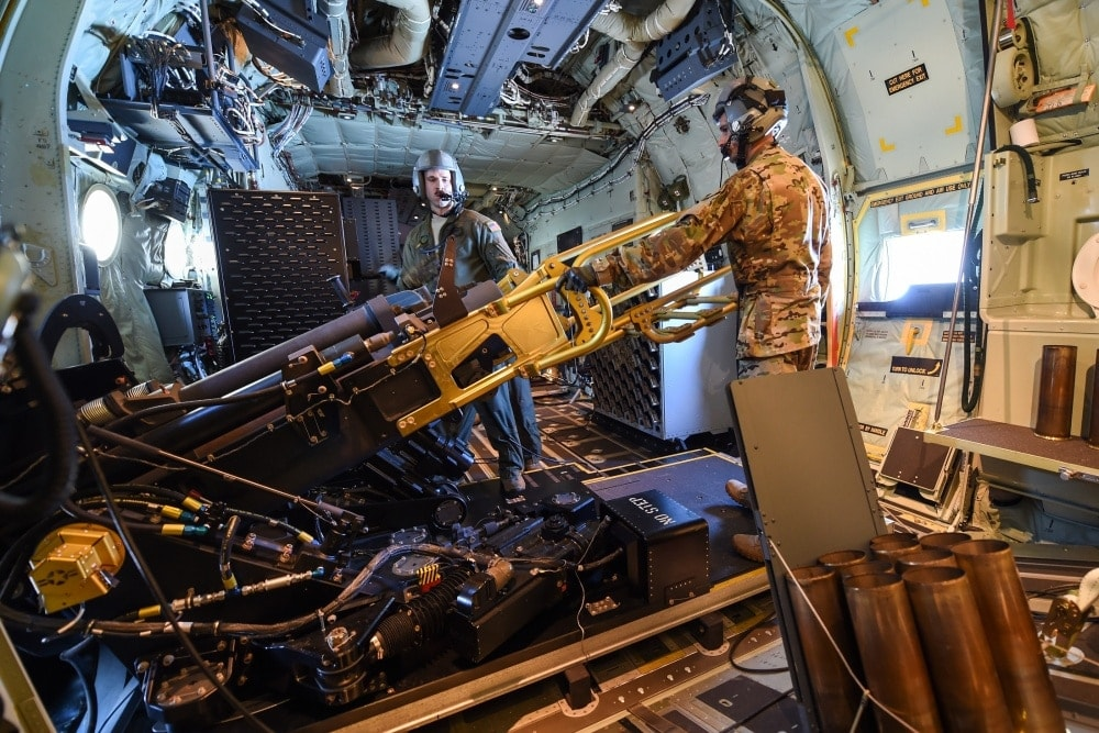For reference the 105mm howitzer recoils back 49 inches into the interior of the converted cargo plane, with 14,000 pounds of force.