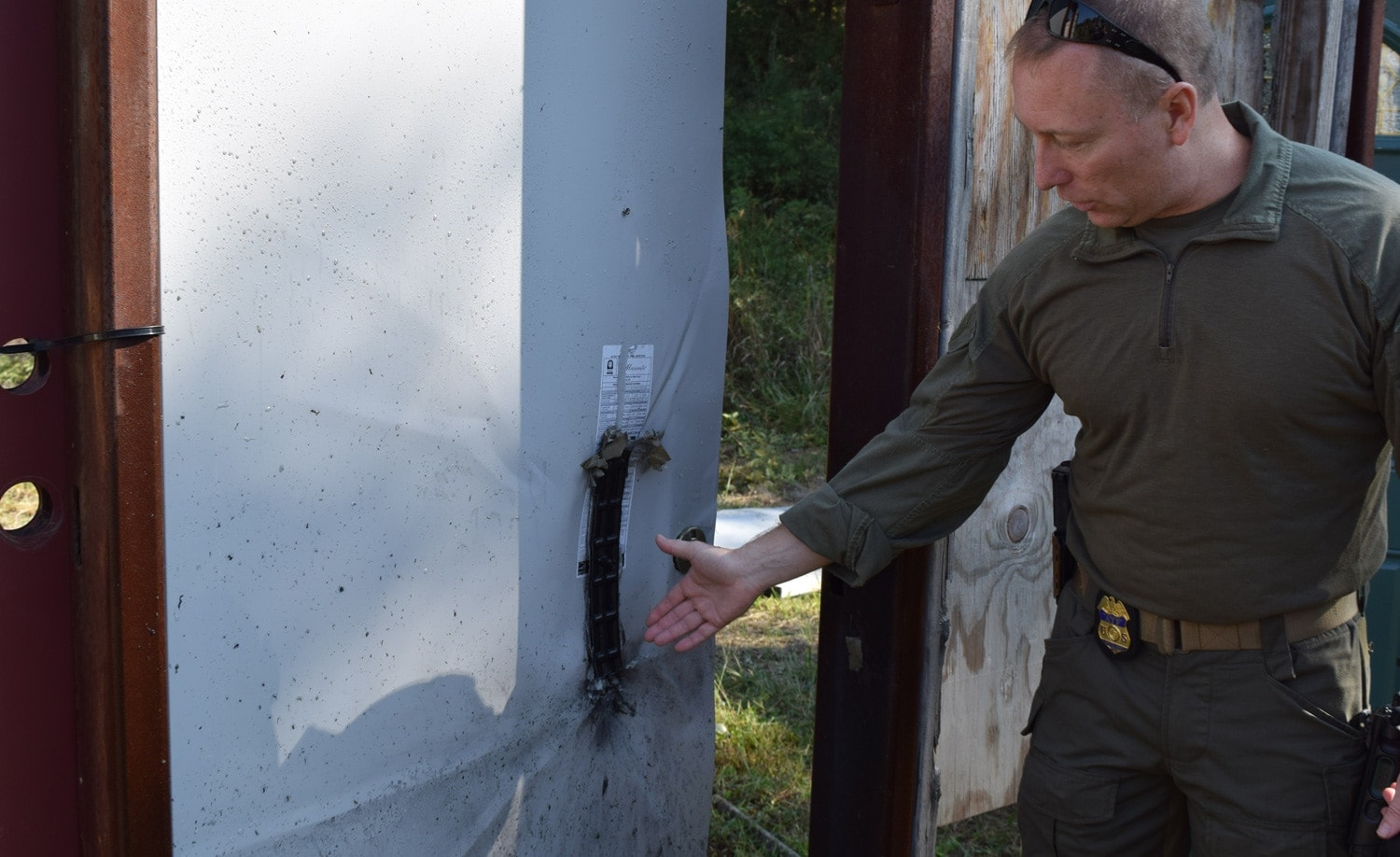 The breach bomb is designed to do just enough damage to open the door. SRT agents practice on a variety of doors in order to understand the science and art of breaching. (Photo: Daniel Terrill/Guns.com)
