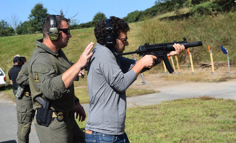An ATF SRT agent guiding a reporter through shooting an HK MP5 machine gun, which is actually no longer used by the team. (Photo: Daniel Terrill/Guns.com)