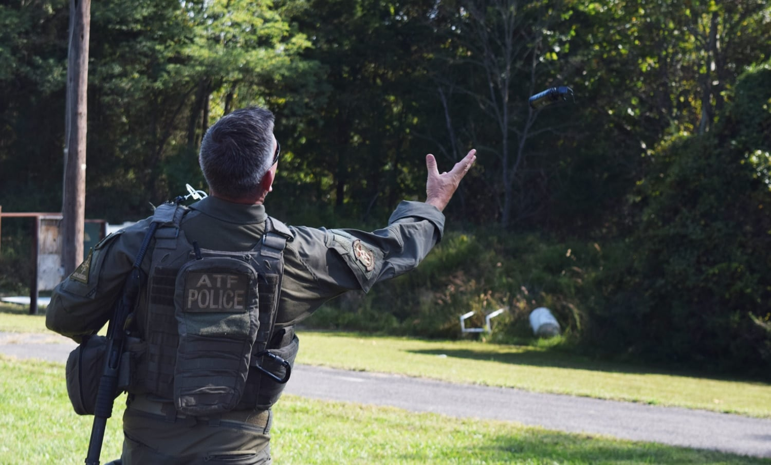 After a door breaching demonstration, an SRT agent tosses a flash bang into the air. The device is supposed to startle, confuse and disorient suspects. (Photo: Daniel Terrill/Guns.com)