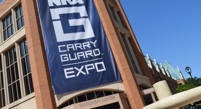 "The ginormous ""NRA Carry Guard"" sign draped down the front entrance of the Wisconsin Center in Milwaukee on Friday, Aug. 25, 2017. (Photo: Daniel Terrill/Guns.com)"