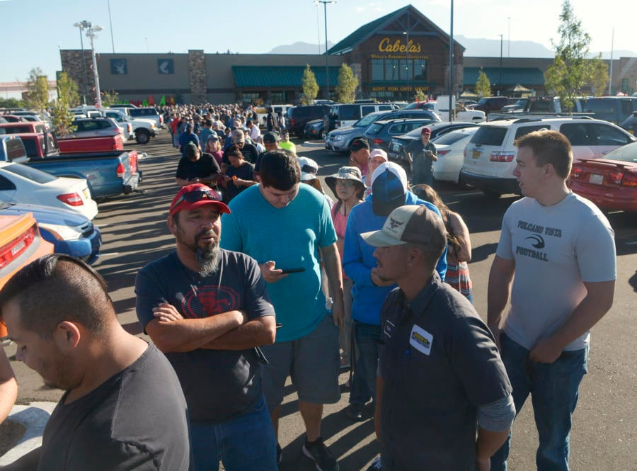 Thousands of customers stand in a line that wound its way through the parking lot to enter Cabela's, the national outdoor outfitter, during it's grand opening on Thursday, September 21, 2017. (Photo: Greg Sorber/Albuquerque Journal)