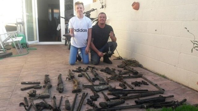 Father, son dredge WWII guns out of river in Great Britain
