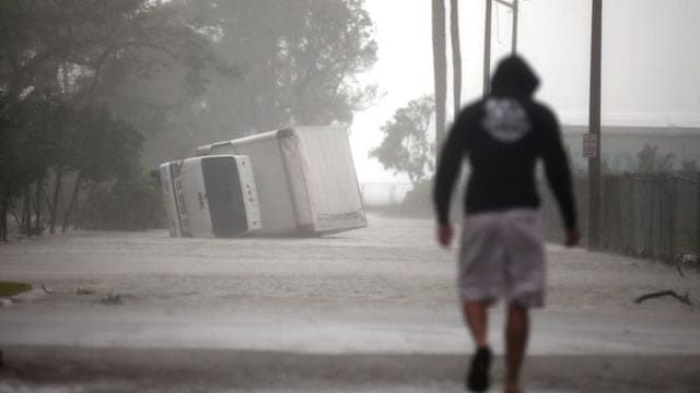 A truck overturned in flood waters as Hurricane Irma passed through Miami Sunday. (Photo: Thomson Reuters)