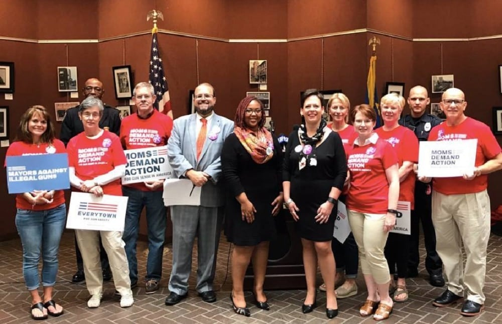 Members of gun control group Moms Demand Action gathered with state lawmakers and law enforcement officials to urge action on a domestic violence gun bill. (Photo: Facebook)
