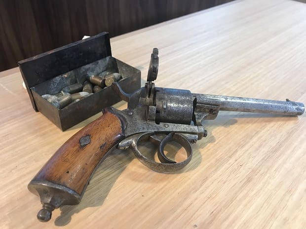 A 150-year-old antique Belgian Lefaucheux 9mm pin-fire revolver and a tin of original rounds handed into Tasmanian police. (Photo: Ethan James/AAP)