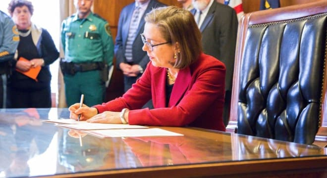 Gov. Kate Brown, a Democrat, signed the measure into law in August after it squeaked through the legislature, which gave opponents just weeks to gather enough signatures send the issue to voters. (Photo: Gov. Brown's office)