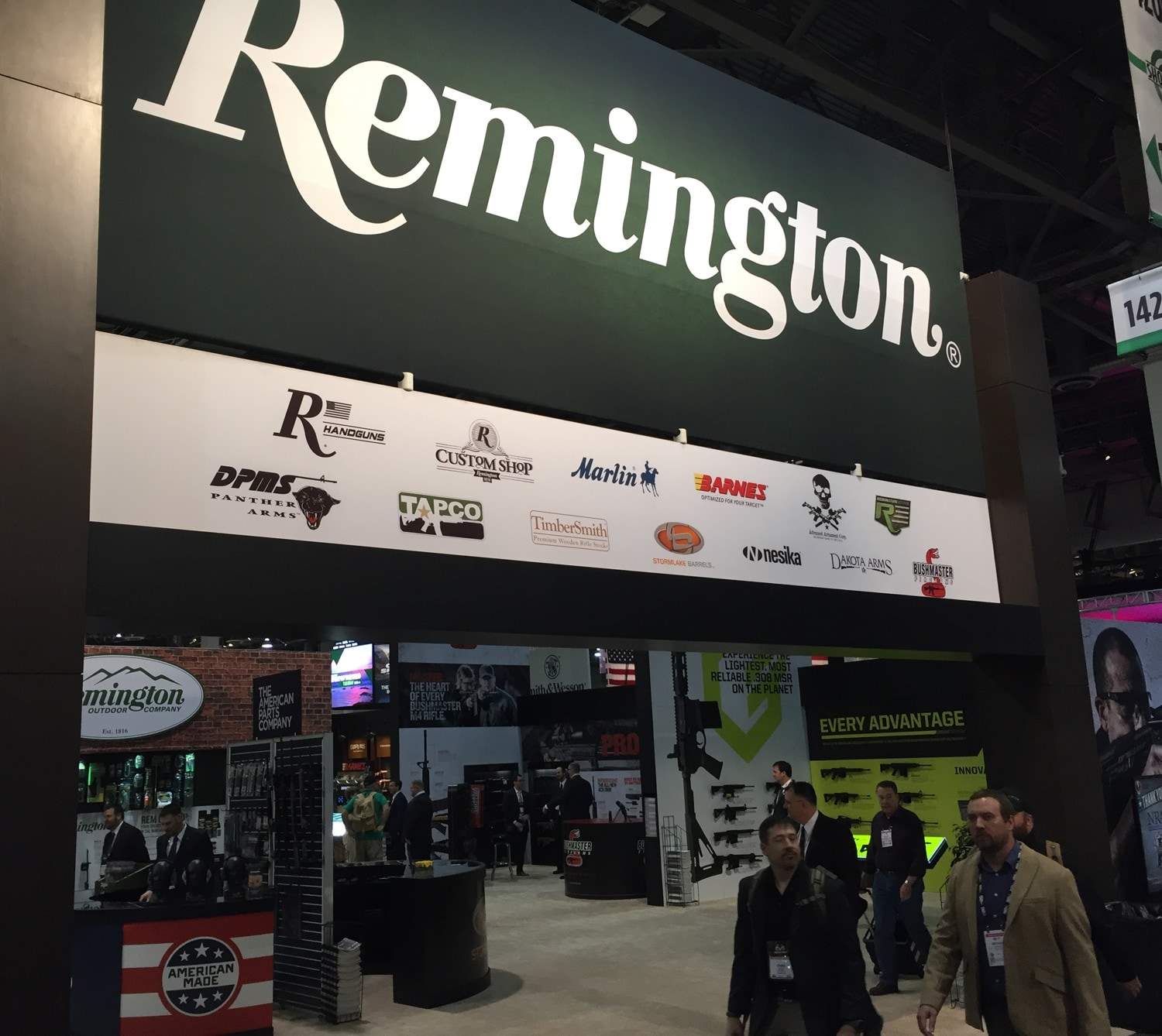 Some dapper gents walking by the Remington booth at SHOT Show 2017. (Photo: Daniel Terrill/Guns.com)