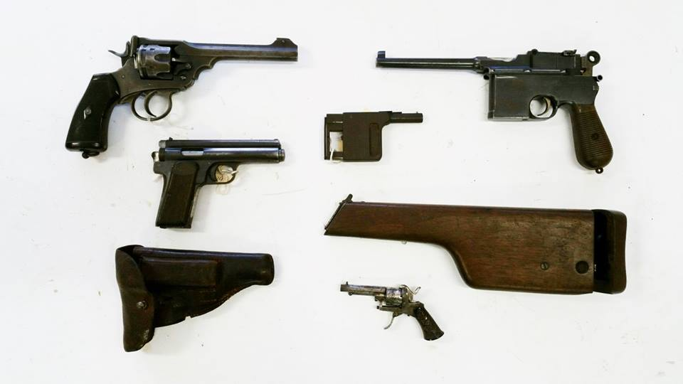 The handguns are a Webley Mk VI, a flat-side C96 Mauser, Frommer Stop, Gaulois palm pistol and a pinfire revolver with folding trigger. (Photo: LSAFM)