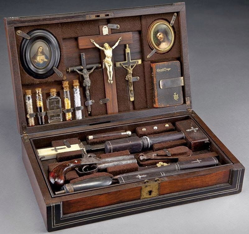 "This Dallas Auction, which went for an impressive $8K, included a ""black powder percussion 2-barrel pistol, a powder horn and bullet mold, bone handled dagger with crucifix, three small crucifixes, mallet and two wooden stakes, book of common prayer, two small framed portraits of Jesus, holy water and four glass vials with crystals."" https://dallasauctiongallery.hibid.com/lot/8077065/cased-vampire-killing-kit--in-a-rosewood"