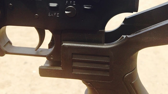The bump stock attached to an AR rifle. (Photo: Eve Flanigan/Guns.com)