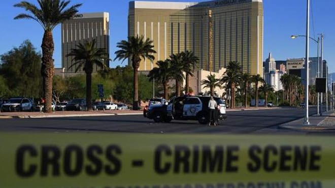The crime scene outside Mandalay Bay after a mass shooting the night before. (Photo: The Mercury News)