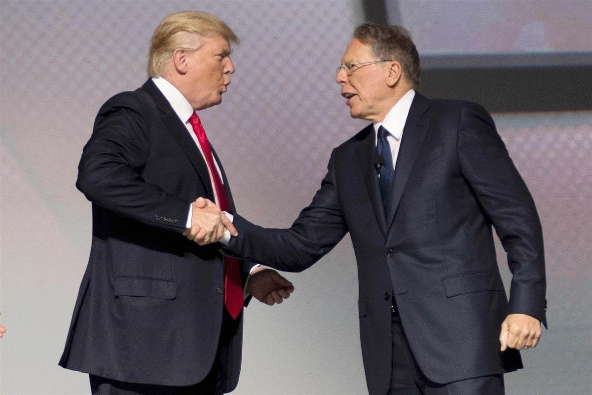 President Donald Trump and NRA president Wayne LaPierre shake hands on stage at the NRA leadership forum in April. (Photo: Getty Images)