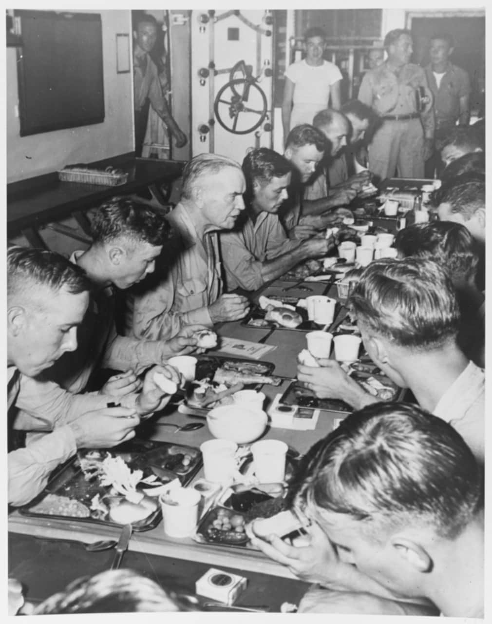 Admiral William F. Halsey, Commander, Third Fleet (left center) eats Thanksgiving dinner with the crew of his flagship, USS New Jersey (BB-62), 30 November 1944. (Photo: National Archives)
