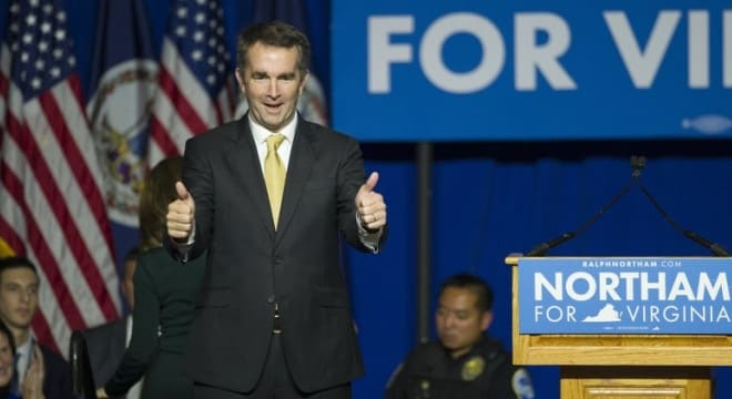 Virginia Gov.-elect Ralph Northam celebrates his election victory Tuesday night at a part at George Mason University in Fairfax. (Cliff Owen/AP)