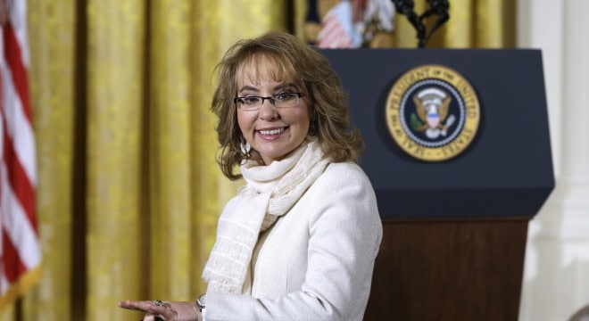 In this file photo from Jan. 5, 2016, former U.S. Rep. Gabby Giffords arrives in the East Room of the White House in Washington to hear President Obama speak about executive actions on gun control.(Photo: Carolyn Kaster/AP)