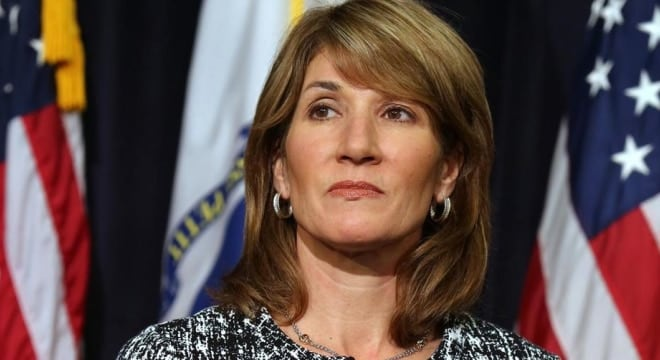 Filling in for Gov. Charlie Baker, Massachusetts Lt. Gov. Karyn Polito signed a bump stock ban into law last week, the first adopted since the Route 91 Harvest festival shooting in Las Vegas. (Photo: Boston Globe)