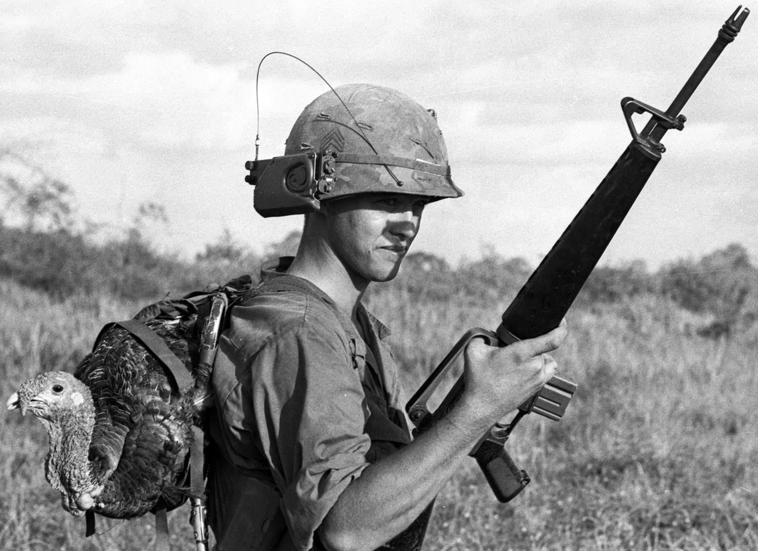 """""""South Vietnam, November, 1967 SSG Raymond Scherz of Addison, Ill., C Company, 2nd Battalion, 39th Infantry, 9th Infantry Division's Thanksgiving dinner at the nearby Bear Cat base camp"""""""