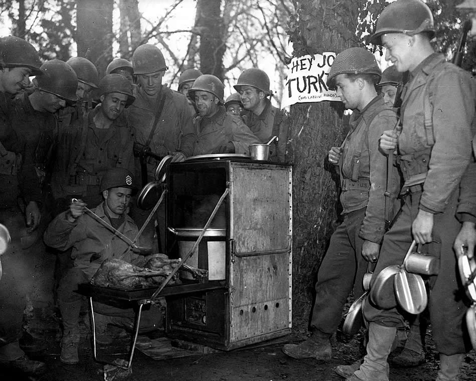 Firing up the trusty M1937 field kitchen, the Army way