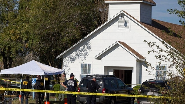 Law enforcement officials works at the scene of a fatal shooting at the First Baptist Church in Sutherland Springs, Texas, Nov. 5, 2017. (Photo: Nick Wagner/ Statesman.com via AP)