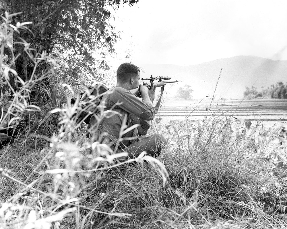 """A Marine sniper from G Company, 2nd Battalion, 9th Marines, takes aim while on the approach to Hill 251 during the Operation HARVEST MOON. 12 December 1965."" Note the Unertl. (Photo/caption: U.S. Marine Corps History Division)"