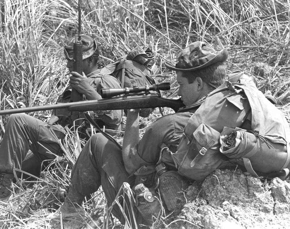 """A sniper of Co. D., 1st Bn., 4th Marines, takes aim on movement up front during Operation Nanking. October 14 1968"" (Photo/caption: U.S. Marine Corps History Division)"